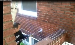 Black Stains being removed from Brick and Tuckpointing work