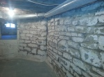 Open joints in basement stone wall ready to tuckpoint