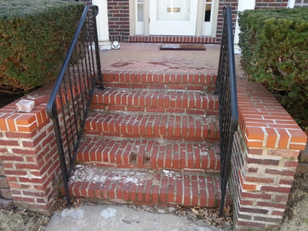 Brick steps deteriorated from salt, ice and neglect